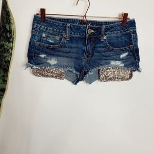 • AMERICAN EAGLE • gold sequin shortie jean shorts
